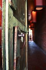 a pathway in Chinatown (1ragincajun) Tags: door metal hawaii chinatown indigo rusty lamps pathway