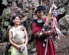Tagin shaman with wife and baby (Linda De Volder (the new layout is horrible)) Tags: india canon geotagged priest tribe sevensisters shaman arunachal 7sisters arunachalpradesh northeastindia daporijo powershots5is tagin lindadevolder