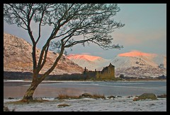 Kilchurn Castle, Loch Awe, Scotland (ericwyllie) Tags: morning trees winter snow mountains colour nature clouds sunrise landscape outdoors dawn scotland eric time outdoor background backgrounds loch 2010 gloaming lochawe kilchurncastle ericwyllie imagetype photospecs