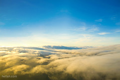 Magical Clouds (Heilah Alnasser) Tags: sky clouds airplane scotland nikon nikkor goldenhour d300 heilahalnasser