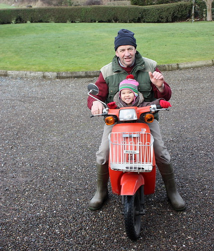 on the moped with papie