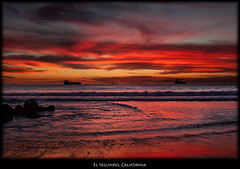 Red California Sunset (szeke) Tags: ocean california sunset usa beach rock clouds landscape boat us losangeles ship unitedstates pacific manhattanbeach elsegundo 2010 oiltanker imagenomic nikviveza blendinphotoshop