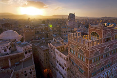 Stock Image of The Old City of Sanaa - Yemen (Michele F.) Tags: old city trip travel roof sunset vacation sunlight house holiday building tower tourism rooftop window wall skyline architecture sunrise landscape design town ancient scenery cityscape arch mud minaret traditional scenic middleeast aerialview arches mosque tourist unescoworldheritagesite arabic arab stunning remote yemen arabian sanaa oldbuilding mudbrick middleeastern turism yemeni turist walledtown saana capitalcity islamiccountry arabianpeninsula saanaa worldlocation worlddestination
