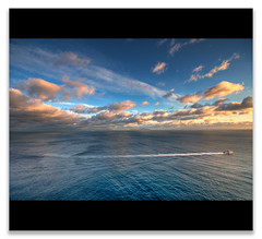 Between Sea and Sky (gabrielescotto) Tags: sea sky italy art clouds photoshop capri nikon bravo italia raw nuvole mare cielo napoli naples procida hdr scia photomatix scafo gabrielescotto d300s nikond300s