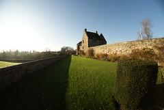 Aberdour Castle (cheesemonster) Tags: old castle history grass wall bright flag lawn perspective sunny wideangle bluesky fisheye hedge historicscotland hs olde antiquity yeolde aberdour aberdourcastle scottishflag blueskybritain