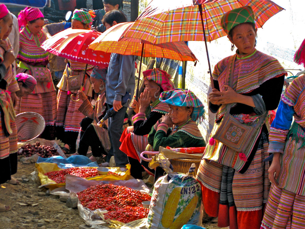 Bac Ha Market : Colourful women selling chilli's and gossiping. Vietnam