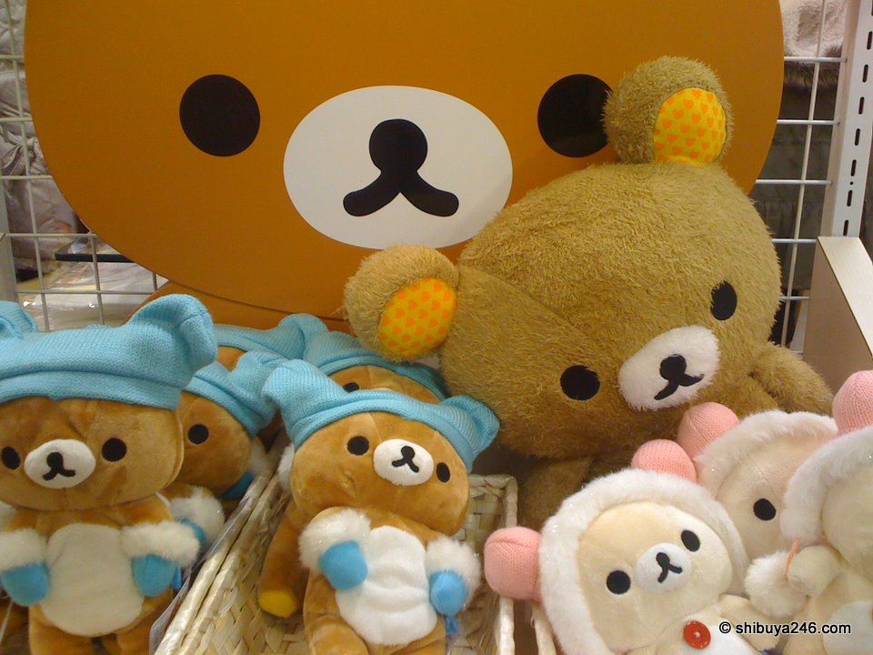 Looks like Rilakkuma might be getting ready to go out into the cold. He has gloves and hat on. Maybe this is a winter edition plush.