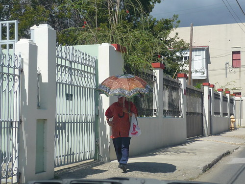 Walking with an umbrella in Ponce II
