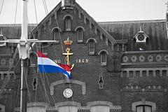 Koninklijk Instituut voor de Marine (IMG_0277 Splash color) (Van der Hoorn) Tags: flag denhelder selectivecolor selectivecolour vlag selectivecolouring selectivecoloring canonefs1785mmf456isusm koninklijkinstituutvoordemarine splashcolor