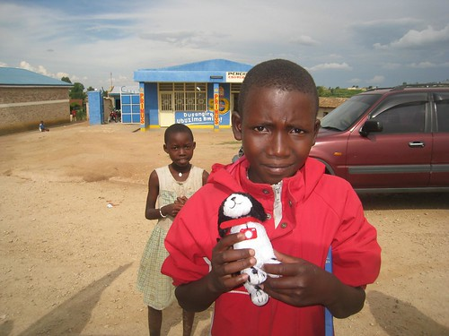 A Rwandan boy poses with Foto, the symbol of the Dog Meets World project.