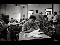 The Coffee House Reader (Satyaki Basu) Tags: travel friends people india house heritage history coffee canon table photography eos eating dr indian culture 1750 tamron kolkata bengal bnw calcutta gossip adda basu westbengal satyaki 450d gettyimagesmiddleeast