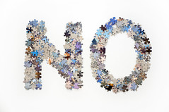 The word no made from jigsaw puzzle pieces