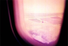 These are the modern times (ale2000) Tags: trip travel pink sky black blur travelling window clouds plane geotagged blurry xpro nuvole purple crossprocess cosina wing rosa outoffocus cielo ala unfocused agfa nero viaggio aereo cx2 mosso oblò nubi ctprecisa blurriness finestrino sfuocato viaggiare aledigangicom geo:lat=51724317 geo:lon=504457
