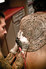 Aztec Calendar (timothycyrus) Tags: art beautiful beauty tattoo canon painting photography gangster gun artistic aztec machine tattoos mexican macabre dslr bodysuit gangsta xsi azteccalendar azteca cholo mayancalendar 450d aztectattoo timothycyrus wwwtimothycyruscomsacramento aztecatattoo aztectatto