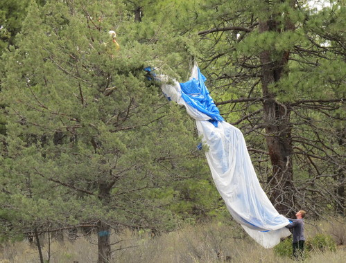 Cutting down one of the parachutes