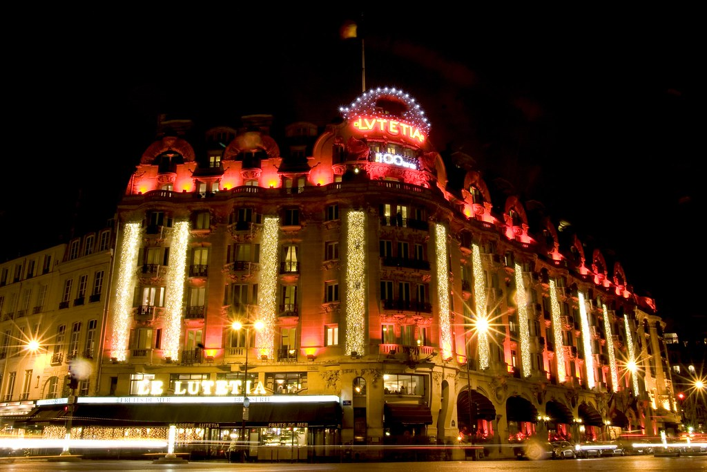 Brightful red lights decoration on the facade of the famous art deco Hotel Lutetia Rive Gauche in Paris celebrating its 100 years