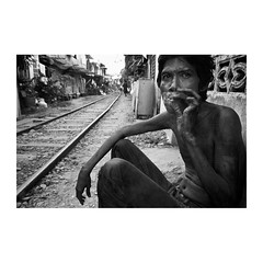 . (Emmanuel Smague) Tags: poverty leica travel portrait people blackandwhite bw man film 35mm thailand photography asia report documentary railway smoking mp misery handicap precariousness emmanuelsmague alongtherailway
