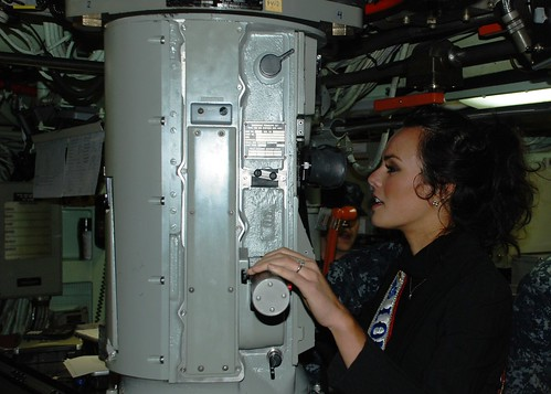 Miss Louisiana USA looks through submarine periscope