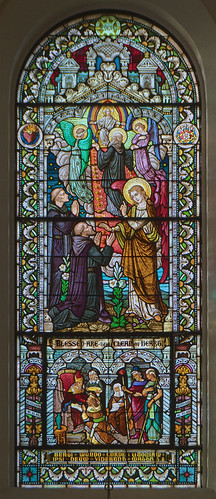 Saint Meinrad Archabbey, in Saint Meinrad, Indiana, USA - stained glass window of Benedictine Saints, and the Patriarch Joseph with Pharoh