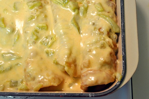 Enrollado Casserole with green chile cheese sauce