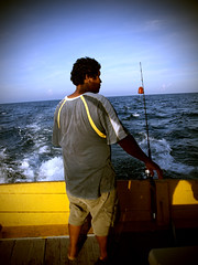The New Deckie of Paka (kevinpoh) Tags: boy sea man lomo fishing offshore kitlens olympus malaysia malaysian zuiko malay terengganu paka angling paklong deckhand 1442mm e620