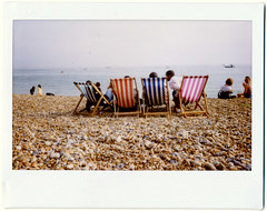 Gang of Four (AndyWilson) Tags: sea summer film beach polaroid brighton fuji wide shingle instant 100 behind deckchairs instax
