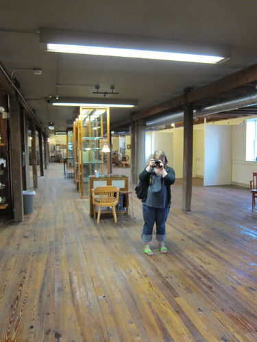 Marisa in an empty antique store