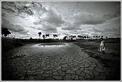 Thirst  [..Chuadanga, Bangladesh..] (Catch the dream) Tags: summer bw man reflection broken water monochrome rain weather clouds rural blackwhite pond village earth horizon wide crack soil drought land dried thirst bangladesh climatechange climate cracked draught dryseason chuadanga gettyimagesbangladeshq2