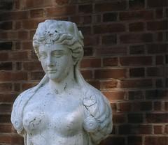 (post.ndakota) Tags: statue brick stone eyes demure brown portrait allertonpark