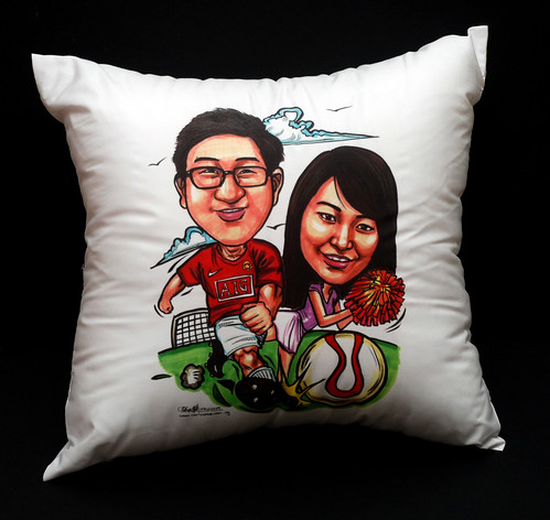 Couple caricatures - Man U soccer player + pong pong girl on cushion