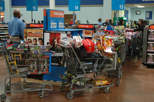 The Salvation Army and Walmart employees shop for kids toys to distribute at Toy Shop on Thursday.