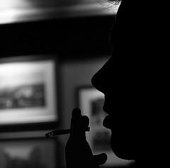 that jazzy B (ssj_george) Tags: pictures leica light shadow portrait people blackandwhite bw music white man black face silhouette night hair suck nose lumix person grey holding alone hand head cigarette smoke fingers profile gray cyprus jazz blowing lips smoking panasonic ashes photographs solo single figure ash features forehead smoker delicate 1001nights hold jazzy limassol limasol enface sideportrait jazzyb κύπροσ georgestavrinos λεμεσόσ fz38 λεμεσσόσ fz35 ssjgeorge γιώργοσσταυρινόσ chrisbyarsarirolandquintet