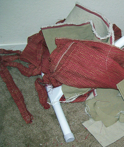 chaise scraps and red worn fabric