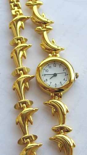 Gold plated Dolphin watch and bracelet from Crimeajewel
