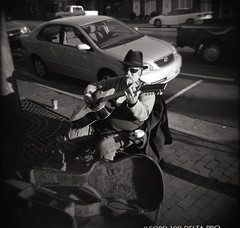 the guitar man (loganbertram) Tags: street bw white black 120 film franklin nc holga hill north chapel carolina medium format unc carborro loganbertramphotography