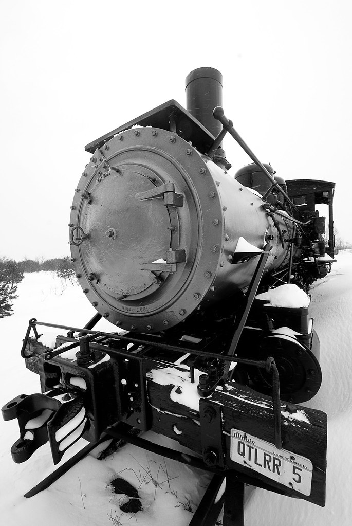 A black and white steam engine.