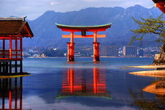 Torii of Itsukushima Shrine (torode) Tags: blue red sea mountains reflection tree japan gate shrine hiroshima miyajima torii itsukushima bentorode benjamintorode