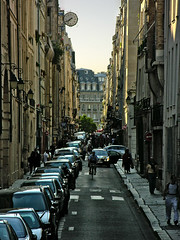 Paris Street III (nina's clicks) Tags: street travel sunset paris france canon nikon cyclist p ilestlouis parisstreet