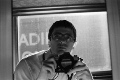 Scan11391ccx (citatus) Tags: citatus me selfportrait bobcummings lovethatbob train viarail vancouver 1981 bw mirror selfie