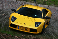 Murcielago (RobbertK) Tags: black holland cars netherlands dutch car yellow canon italian rotterdam d nederland super 400 lp hyper 28135 bugatti geel lamborghini supercar zonda supercars veyron murcielago 640 eb110 hypercar 400d zenvo