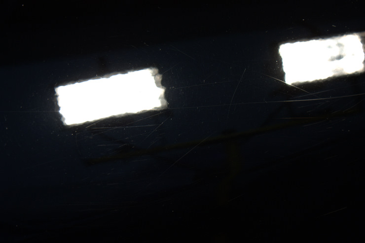 2008 Cadillac STS-V zoomed in to reveal deeper scratches