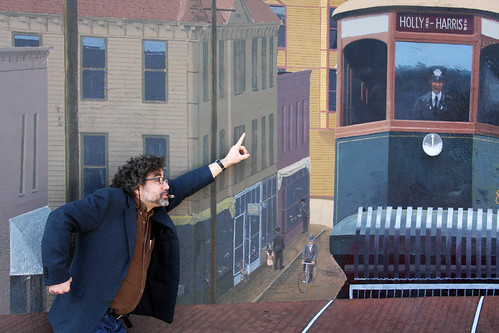 The Philosopher hails the streetcar which took him to the train on which he departed for Boston Harbor to serve his new Master, none other than Mad Captain Alex!