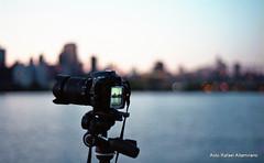 Waiting for the right time (Rafakoy) Tags: camera city nyc ny newyork film water skyline 35mm photo bokeh dusk manhattan tripod nikonf100 epson v600 longislandcity perfection manfrotto kodakgold200 nikond90 epsonv600 epsonperfectionv600photo nikkorafs18105mmvr aldorafaelaltamirano rafaelaltamirano aldoraltamirano