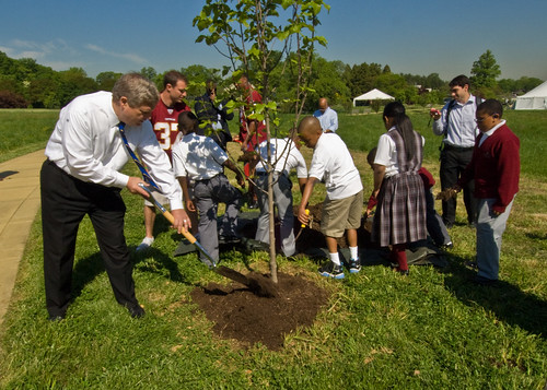 Secretary Vilsack and students plant a tree on Arbor Day
