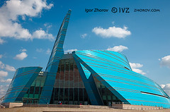 Glass building. (i_zhorov) Tags: life city blue summer sky urban cloud reflection tree glass horizontal architecture buildings outdoors design office construction cityscape exterior place contemporary low nobody scene structure kazakhstan futuristic built feature astana 5photosaday