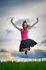 Vannessa (Sergiu Bacioiu) Tags: pink sunset portrait sky cloud green nature girl field grass clouds hair jump wind cloudy outdoor dusk vannessa