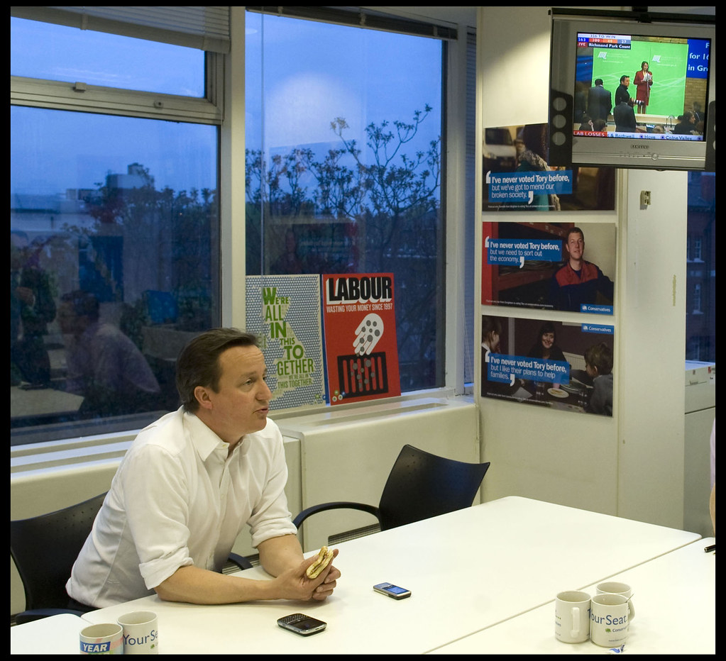 David Cameron eats his breakfast in his office in CCHQ as he watches the election results come in