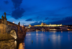 Charles Bridge (Philipp Klinger Photography) Tags: city longexposure bridge blue light shadow sky orange cloud color reflection water saint yellow statue night clouds river gold golden evening colorful europa europe long exposure republic nocturnal czech prague saints illumination vivid statues prag charles praha tschechien most hour czechrepublic cz bluehour brcke charlesbridge philipp vltava dri hdr hrad hradcany ceskarepublika republika karlvmost moldau karlv klinger ceska goldencity karlsbrcke prazkyhrad prazky goldenestadt dcdead vanagram