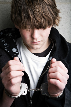 teen crime - kid in handcuffs Summer time means longer days, ...
