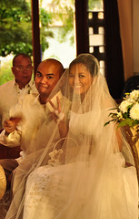 The happy couple (mendhak) Tags: wedding church smile sign happy couple peace symbol random philippines ceremony marriage victory christian cebu